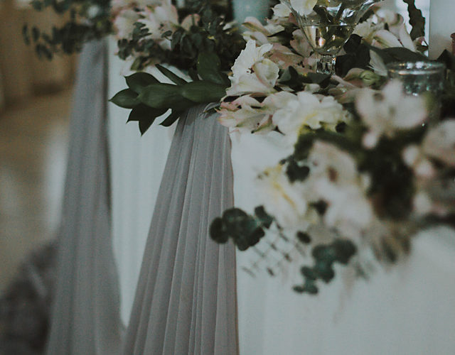 white and grey wedding table white flowers